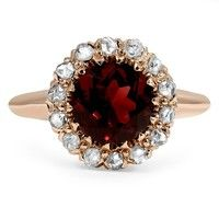 The Auden Ring c1930's - 14K Rose Gold - A captivating red garnet sits at the center of this Art Deco ring in a feminine rose gold setting. Decorating the halo are fourteen rose cut diamond accents for a classic and stunning appeal