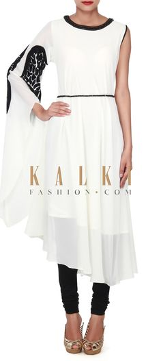 Buy this White kurti enhanced in feather motif only on Kalki