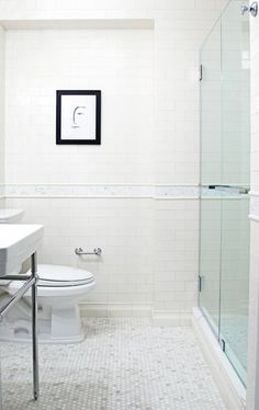 Lauren Rubin, White Bathroom in Upper West Side Apartment, New York | Remodelista - love the hexagonal marble tiles