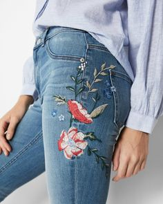Brighten up your denim collection with these embroidered denim leggings done in a flattering high waist and easy-wear stretch fabric. A little destruction at the knees adds to their trend appeal.
