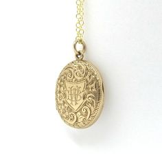 An Edwardian solid yellow gold locket with engraved decoration on both sides. The front is engraved with the monogram BW. Hallmarked 9 carat gold, London 1906. The locket weighs 3.5 grams without the chain. The interior photo frames are missing, otherwise in good condition and closes