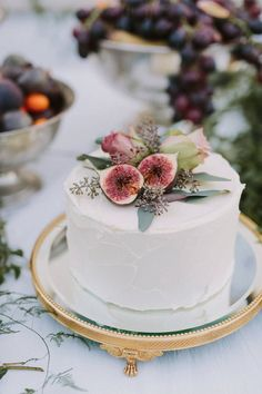 Fig and floral topped cake - perfect sweetheart table cake for the bride and groom!