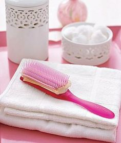 Prevent gunk from settling into your hairbrush by pushing a swatch of stocking fabric over the bristles, so it rests on the base. When the brush needs cleaning, remove the swatch and hair and product buildup will go with it.