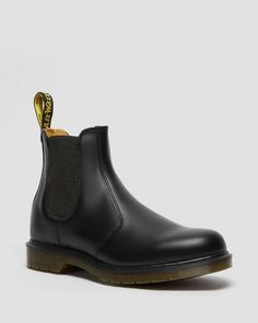 While the first Dr. Martens 2976 Chelsea boot was produced in the early '70s, the original style has Victorian origins. Farmers loved the sure fit and easy-on, easy-off elastic ankle gusset — kickass style was just an unexpected side effect. These days, the 2976 Chelsea boot is a slick, uncompromisingly fashion-forward look for both sexes. Pull-on style, with elastic gussets Part of our 'Lost Archives' collection, this boot is made with the classic Dr. Martens Smooth leather, a lightly ... Dr. Martens, Dr Martens 2976, Dr Martens Chelsea, Platform Chelsea Boots, Platform Boots, Leather Lace Up Boots, Leather Chelsea Boots, Dr Martens Hombres, Chunky Boots