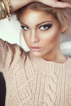 I adore the dramatic eye makeup, but the bronzed, glowing skin is the best part of this look. hair-makeup-nails