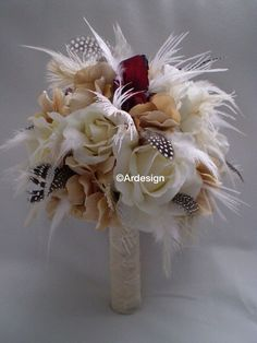 This bouquet features Cranberry/wine high quality latex Cymbidium orchids,ivory roses,beige/ivory hydrangea The stems are wrapped in ivory ribbon accented with sheer french knots Ostrich, guinea and ivory feathers interspersed throughout the piece Art Deco Wedding, Fall Wedding, Our Wedding, Wedding Vintage, Wedding Stuff, Wedding Ideas, Feather Bouquet, Bouquet Toss, Wedding Bouquets