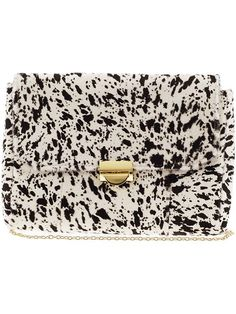 white and black clutch