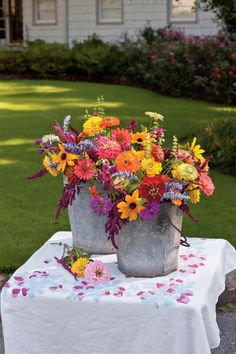 These cheery blooms are easy to grow, require minimal care once established, and yield plenty of flowers for cutting. For quick arranging into a casual bouquet, like the one shown here, place large sunflowers in container first. Then add cockscombs, a great filler that provides texture. Tuck in as many zinnia blooms as possible and finish with small gomphrenas flowers to accent.