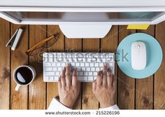 Businesswoman using pc computer on her office table - stock photo
