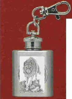"""Wolf Stainless Steel Flask Key Chain by Heritage. $12.95. Wolf Stainless Steel 1 oz Flask Key Chain with highly detailed emblem in fine pewter Buy Any Two Flask Key Chains & the price will be adjusted to the """"Two for Price"""" when the order is processed. This does not apply to Collegiate Emblem Items"""