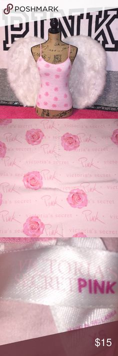 ✨Victoria's Secret Pink Spaghetti Strap Top✨ Victoria's Secret Pink Spaghetti Strap Top with Victoria's Secret Pink written all over it with roses! Only worn twice so it's In perfect condition no rips or stains! Chest Measurement Laying Flat 11 1/2in. Full Length 18 1/2in. ✨Same Day/Next Day Shipping✨  ✨I always describe my items the best I can including flaws & defects✨ ✨Add Items To Bundle For Private Discount Offers!✨ PINK Victoria's Secret Tops Tank Tops