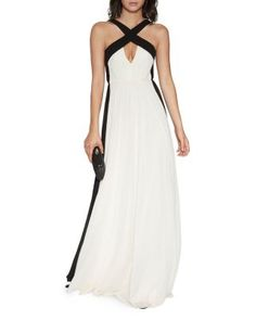 Go for modern romance with this flowing gown from Halston Heritage. A classic color combination lends a timeless look to its color-blocked design, while a front keyhole defines its sultry, stunning ap