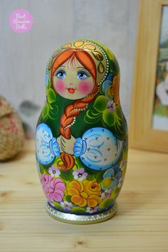 Wooden hand painted russian matryoshka doll set of 5 in green floral shawl. Lovely gift for women!  Nesting-doll is turned from basswood (other name is linden) and hand painted with high-quality gouache paint (tempera). Some details are made with the use of decorative foil. Every russian doll is covered with 3 layers of non-toxic glossy varnish!  This doll is painted by artist Nadezhda Tihonovich (Petrozavodsk city, Republic of Karelia, Russia)  - All our dolls come in handmade organza bags…