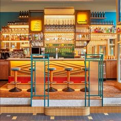 studio modijefsky's la cervecería is a warm pincho & beer bar in amsterdam east, designed to bring the warm side of spain to the dutch capital. Yellow Tile, Black Tiles, Spanish Colors, Vintage Light Fixtures, Wooden Staircases, Amsterdam, Floor Patterns, Beer Bar, Folding Doors