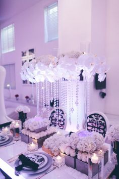 When it comes to the wedding reception décor, all eyes will be on the dinner tables. From low and delicate to high and cascading, get inspired by these magnificent wedding centerpieces. All White Wedding, Mod Wedding, Purple Wedding, Wedding Table, Wedding Flowers, Dream Wedding, Wedding Day, Wedding Reception, Uplighting Wedding