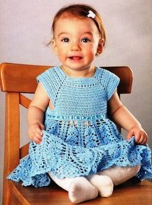 Free crochet pattern. Pattern category: Baby Dresses. Fingering weight yarn. 600-750 yards. Features: Lace. Intermediate difficulty level.