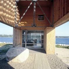 Minimalist home on the rocky seashore