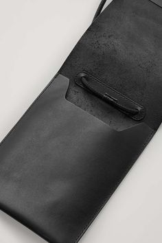 Made from soft leather, this pouch is a contemporary everyday essential. - Tubular strap - Front flap opening - Card slots at the back - Single topstitching at the edges Cow leather x Cow Leather, Leather Craft, Leather Bags, Leather Crossbody, Crossbody Bag, Minimalist Bag, Black Wallet, Leather Projects, Leather Design
