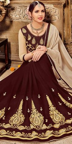 Astounding Brown Georgette Saree.This traditional Saree is beautified with resham work,zari and dori work,stone work on it with matching dhupian blouse which gives you ethnic look.