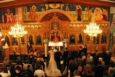 This picture shows the true beauty within all the greek traditions that come with a Greek Wedding. The icons on the walls of the Greek Orthodox Church are a major factor, as well as all the friends and family surrounding to watch the bride and groom marry the love of their life, in front of God.