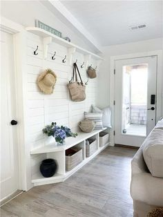 White Warm Minimal Coastal Sophisticated Design Inspiration - Hello Lovely - Charming entry with hooks and cubbies in a coastal cottage in NC called Summerfell. Small Beach Houses, Dream Beach Houses, White Beach Houses, Cottage Living Rooms, Home Living Room, Cottage Rugs, Beach Living Room, Cottage Bedrooms, Coastal Living Rooms