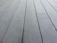 This is a picture of thermally modified Ash decking that was not treated with any wood protection. It has a patina gray color and remains structurally sound and stable. You can coat our thermally modified ash decking with a product called Cutek Extreme and its available in a variety of color choices.