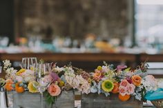 love the idea of a bunch of colorful flowers instead of monochrome arrangements. somehow they still all work beautifully together!