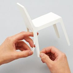 Japanese designer Taiji Fujimori has designed a miniature paper chair, armchair and sofa, one-fifth the size of the standard furniture pieces..
