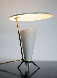 Anonymous; Brass and Enameled Metal Table Lamp by Bag Turgi, c1950.