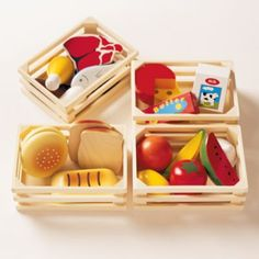 "All four old-fashioned food groups are represented in 24 wooden pieces, including steaks, poultry, dairy products, veggies and grains.  Four crates keep the food neat and organized. Details, details crate: 6 x 4. 5""h food: 2. 5-4""Age range 3 and up."