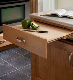 Short on counter space?  This base cabinet features a pull out work surface.