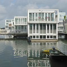 Water-houses in Amsterdam's IJburg neighbourhood by Dutch firm Marlies Rohmer Architects & Urbanists float in concrete tubs