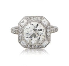A Magnificent Old European Cut Diamond Engagement Ring. The center diamond is surrounded by a halo of 16 Old Mine diamonds and 4 baguette cut diamonds. Estate Engagement Ring, Engagement Ring Buying Guide, Perfect Engagement Ring, Halo Diamond Engagement Ring, Designer Engagement Rings, Vintage Engagement Rings, Engagement Jewelry, Art Deco Diamond Rings, Diamond Jewelry