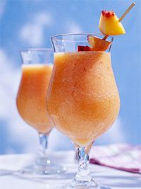 Mango Daquiri:  3 ounces rum   1 1/2 cups cubed fresh mango  3 tbsp lime juice   3 tbsp orange juice  1 oz triple sec   4 teaspoons sugar   2 cups ice cubes  Blend all in blender until smooth. Garnish with fresh fruit slices.