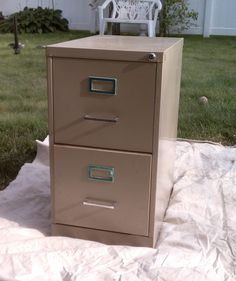 "How to: Paint a Metal File Cabinet I wrote this post a couple of months ago for something else, but it ended up getting bumped, so now I'm sharing it here! Yay, another how-to! So we all know my struggle with our ""office… Painting Metal Cabinets, Painted File Cabinets, Diy Cabinets, Painting A Desk, Painting Furniture, Fabric Painting, Refurbished Furniture, Repurposed Furniture, Furniture Makeover"