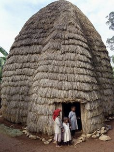 The Dorze people living in highlands west of the Abyssinian Rift Valley have a unique style of building their homes. The twenty-foot-high bamboo frame is. Vernacular Architecture, Futuristic Architecture, Amazing Architecture, Residential Architecture, Cultures Du Monde, World Cultures, African Culture, African Art, African House