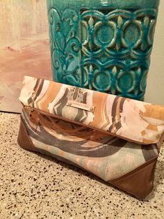 Linen and leather clutch by ZydecoandJazz on Etsy
