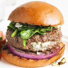 Blue Cheese-Stuffed Burger with Red Onion and Spinach. This juicy burger oozes with melted blue cheese. Topped with fresh spinach, red onion, and the remaining crumbled blue cheese, these stuffed burgers are sure to be a hit. Beef Recipes, Cooking Recipes, Grilling Recipes, Cooking Tips, Grilling Tips, Kraft Recipes, Easy Recipes, Dinner Recipes, Blue Cheese Burgers