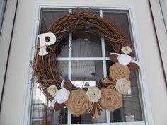 Burlap roses on grapevine wreath.