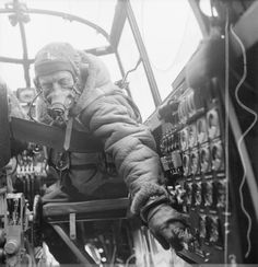 Flying Officer J B Burnside, the flight engineer on board an Avro Lancaster B Mark III of No. 619 Squadron RAF based at Coningsby, Lincolnshire, checks settings on the control panel from his seat in the cockpit. Ww2 Aircraft, Military Aircraft, Luftwaffe, Raf Bases, Lancaster Bomber, Ww2 Planes, Royal Air Force, Military History, Military Art