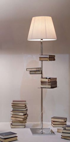 Philippe Starck | Standing lamp is also perfect as a bookshelf with its stainless steel shelves placed beside the central stem. Designed by Philippe Starck, 2013.