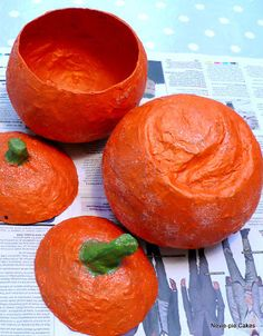 This is a fantastic autumn project for your little ones! A paper mache pumpkin which can also be used as a treat holder.  My own darlings...