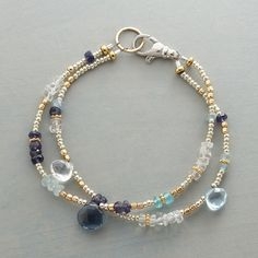 SHARI BRACELET--Metallic seed beads and clear quartz set the stage for a panoply of blues, including aquamarine, iolite, blue topaz. Exclusive. Handmade in USA
