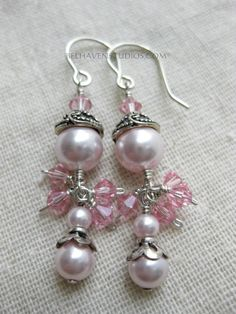 Swarovski crystal pearls and crystals decorative sterling silver drop earrings wedding dressy special occasion jewelry Luminous soft pink Swarovski round crystals pearls and bicone shaped light rose Swarovski crystal beads. Decorative Balinese oxidized sterling silver beadcaps crowning the crystal pearls. 2 tiers of crystals are wired with sterling silver wire. Hangs from my handmade handformed 925 sterling silver earwire hooks.  Size: 2 inch (5.08 cm)  ITEM # ER-BSS SCPKROS 001  more…