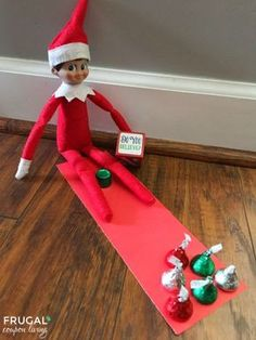 Are you following all of Frugal Coupon Living's Elf on the Shelf Ideas? See well over 100s of creative, funny, and original ideas for your Elf! Take a trip to the lanes with this Elf Bowling Candy Game. #elf #elfgame #elfontheshelf #elfontheshelfideas #elfideas #elfdoll #elfie