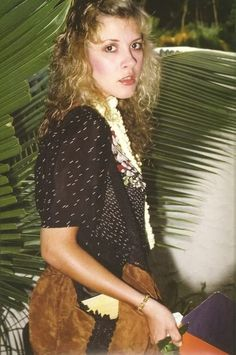 Stevie ~ ☆♥❤♥☆ ~  dressed in casual clothes and carrying a large brown suede handbag, eyeing the camera warily