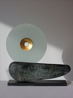 Peter Hayes Glass Disc with Gold Inset on Boat Form Ceramic and mixed media 39 x 40 x 7 cms Price: £950