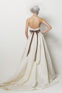 Santa Barbara Gown by Wanners.com - LOVE the brown Melrose detailed waist belt... Ivory silk taffeta strapless dress with pleated bodice, covered buttons and full skirt with chapel train and pockets.