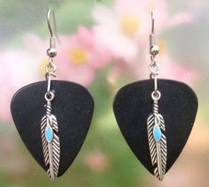 Add a touch of southwestern flair with these feather guitar pick earrings. Choice of 12 colors, Native American jewelry