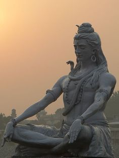 Shiva statue on the Ganges River, India.  Bucket list : Visit the Ganges!